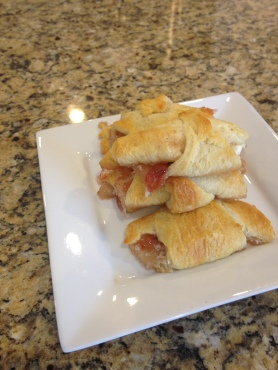 Strawberry & Cream Cheese Breakfast Pastries. SImply unroll crescent roll dough, fill with cream cheese and jam, roll and bake on a sheet pan!